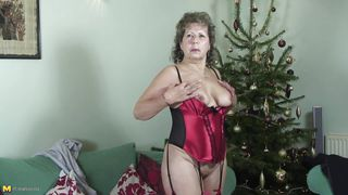 slutty granny playing with herself in bed.