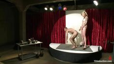 blonde shemale and her obedient male in the spotlight