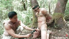 naked gay tied and dominated in the forest