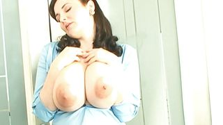 huge boobs brunette squeezing her melons