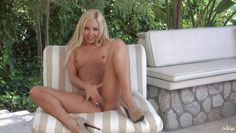 blonde babe fingering her pussy outdoor.