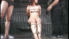 asian girl is hung upside down in prison