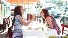 two gorgeous girls touching each other