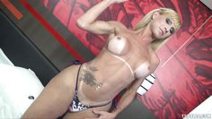 tattooed tranny displays her massive pecker