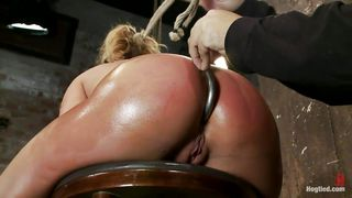 blonde gives head while having a metal hook in her ass