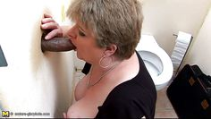 mature sucking a bbc through glory hole