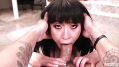 attractive asian brunette blowing a big cock