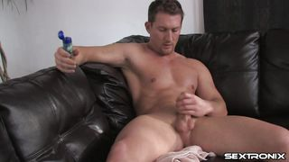 sexy white male oiling himself before masturbating