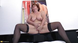 mature fingering her shaved vagina and moaning with pleasure