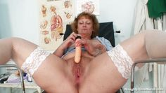 granny nurse masturbating with a big dildo at the work
