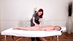 redhead masseuse rubs a naughty blonde