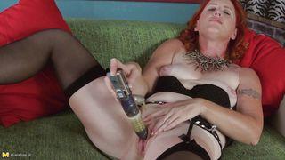 mature redhead has her favorite dildo