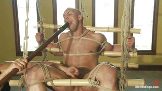bald guy getting bdsm punishment