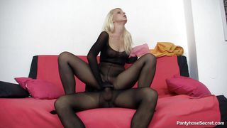 couple wearing black pantyhose having hard sex on the sofa