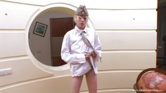 skinny blonde taking off her uniform