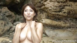japanese milf gives a blowjob on the beach