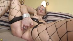 mature blonde fingering her shaved cunt