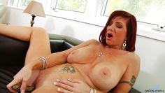 classy mature plays with her dildo