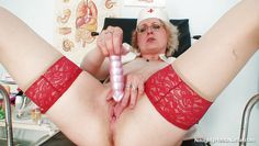 sexy blonde nurse masturbating with a dildo at workplace