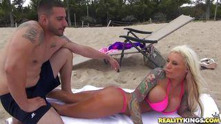 big tits sunbathing