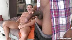 muscular gay guy giving head to a black man