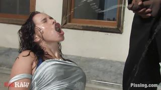 brunette getting wet from a lot of urine
