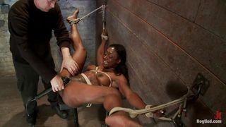 tied ebony slut and a black vibrator