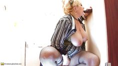 mature blonde sucks a black cock