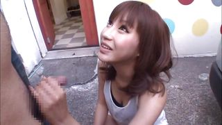 asian teen is giving blowjob outdoor