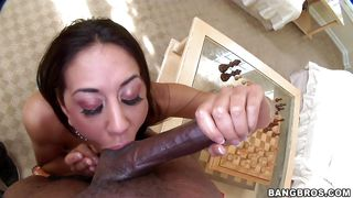 young brunette woman sucks a black man's hose