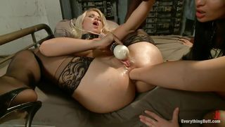 blonde bitch with collar is fisted deep in her anus