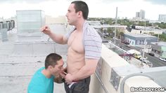 rooftop blowjob of two horny dudes