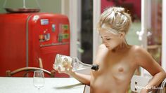 naked blonde cutie playing with an empty bottle
