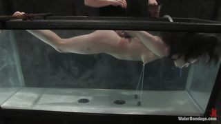 naked brunette tied and submersed in water