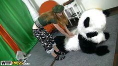 cuddling with her big, furry panda