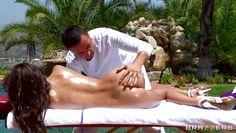 hot brunette getting oiled at massage outdoor