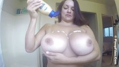 busty latina rubs the lotion on her skin
