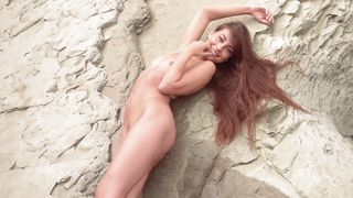 sensual lorena masturbates on the sandy shore