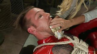 latex slave is tied up and fucked