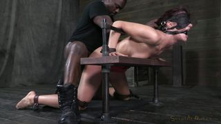 squeezed in a bondage device and fucked hard
