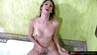 cute t-girl is dancing in string bikini and wanking wet cock