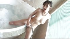 sexy japanese milf masturbates in the tub