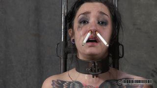 two cigarets to the nose of bondage girl