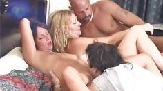 swinging couple engages in coitus