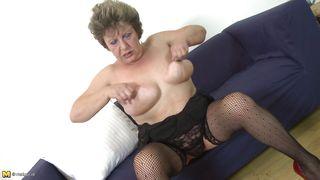 mature tastes her tits