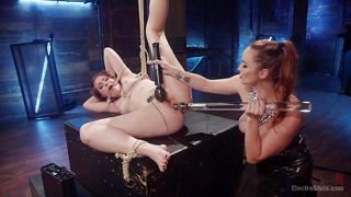 redhead gets fucked by toys in her mistress' pleasure room