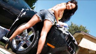 a sensual car wash by a sexy brunette.