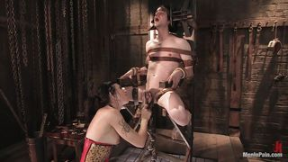 tortured by a devilish brunette