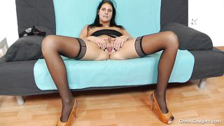 cougar ruby fucks herself with a dildo