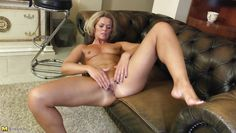 mature blonde takes care of her pussy